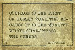 First of qualities Aristotle. Courage is the first of human qualities - ancient Greek philosopher Aristotle quote printed on grunge vintage cardboard royalty free stock photos