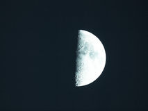 First quarter moon. Moon first quarter seen through a telescope image taken with my own telescope - no NASA images used - cool cold tone royalty free stock image