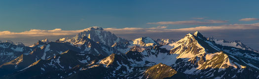 First rays of raising sun on mountain peak.  Royalty Free Stock Photos
