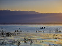 First rays of the sun and fishermen Royalty Free Stock Image