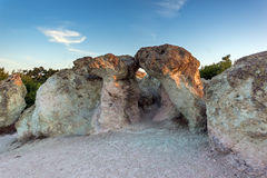 The first rays of the sun over  The Stone Mushrooms near Beli plast village, Bulgaria Royalty Free Stock Photography