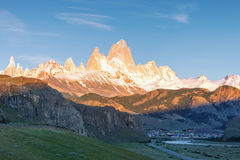 First rays of sun at sunrise over Mount Fitz Roy or Cerro Chalte Royalty Free Stock Photos