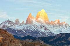 First rays of sun at sunrise over Mount Fitz Roy or Cerro Chalte Stock Image
