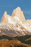 First rays of sun at sunrise over Mount Fitz Roy or Cerro Chalte Stock Photos