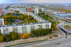 First residential district. Tyumen. Russia. Tyumen, Russia - September 7, 2015: Aerial view on long building, so called china wall. First residential district Stock Image