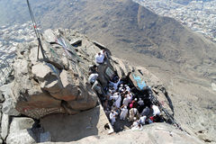 The first revelation came to the cave where the prophet Muhammad. MECCA, SAUDI ARABIA - FEBRUARY 3 : Muslims awaiting their turn to perform prayers at the cave Stock Photos