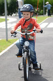 First ride. 3 years old boy and his first ride on bike Royalty Free Stock Photography