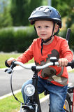 First ride. 3 years old boy and his first ride on bike Stock Photos