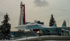 The first rocket Vostok and fighter at an exhibition in Moscow in winter. 2016 stock photography