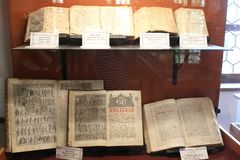 Old rare historic books display Romanian Museum Brasov. First Romanian School Museum Housed on the grounds of St. Nicholas Church, this was for centuries one of stock photo