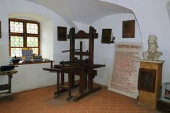 Old printing press museum exhibition Brasov Romania. First Romanian School Museum Housed on the grounds of St. Nicholas Church, this was for centuries one of the stock photo