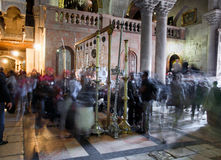 The first room at the entrance to the Temple of the Holy Sepulch. Church of the Holy Sepulchre. Israel, Jerusalem. A large number of pilgrims. Shooting on a Stock Photography