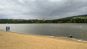 First run. Couple of athletes recuperates after jogging around the lake royalty free stock photos