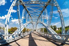 First in Russia steel arch bridge on river Msta in Borovichi. BOROVICHI, RUSSIA - AUGUST 6, 2016: First in Russia steel arch bridge on river Msta. Historic iron Royalty Free Stock Photography