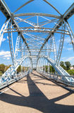 First in Russia steel arch bridge on river Msta. BOROVICHI, RUSSIA - AUGUST 6, 2016: First in Russia steel arch bridge on river Msta. Historical iron bridge. Was Royalty Free Stock Image