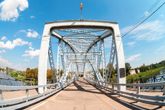 First in Russia steel arch bridge on river Msta. Historic iron b Royalty Free Stock Image