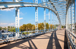 First in Russia steel arch bridge on river Msta. Historic iron b Stock Photo