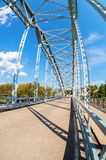 First in Russia steel arch bridge on river Msta. Historical iron Royalty Free Stock Images