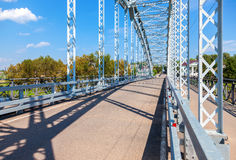 First in Russia steel arch bridge on river Msta. Historical iron bridge. Was build in 1905 Royalty Free Stock Images