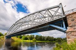 First in Russia steel arch bridge on river Msta in sunny summer. Day. Was built in 1905. Borovichi, Russia Royalty Free Stock Images