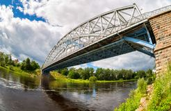 First in Russia steel arch bridge on river Msta in sunny summer. Day. Was built in 1905. Borovichi, Russia Stock Photography
