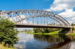 First in Russia steel arch bridge on river Msta in sunny summer. Day. Was built in 1905. Borovichi, Russia Stock Images