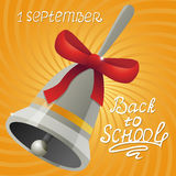 The first school bell with the inscription 1 September and back to school.  Stock Photography