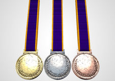 First Second And Third Medals. A set of blank gold, silver and bronze medals with ribbons on an isolated white studio background Stock Photography