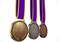 First Second And Third Medals. A set of blank gold, silver and bronze medals with ribbons on an isolated white studio background Royalty Free Stock Photography