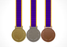 First Second And Third Medals. A set of blank gold, silver and bronze medals with ribbons on an isolated white studio background Stock Photo