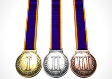 First Second And Third Medals. A set of gold, silver and bronze medals with ribbons on an isolated white studio background Royalty Free Stock Photos