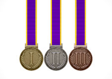 First Second And Third Medals. A set of gold, silver and bronze medals with ribbons on an isolated white studio background Stock Image