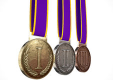 First Second And Third Medals. A set of gold, silver and bronze medals with ribbons on an isolated white studio background Stock Photos