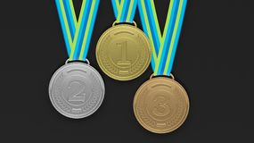 First,second and third place medals on black background. Close-up of 3D medals of silver,bronze and gold on black background.Isolated Royalty Free Stock Photo