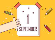 First september. Hand with calendar and colored pencils.  Royalty Free Stock Images