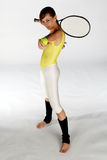 First Serve. A young girl posing with a ball and tennis racket stock photos