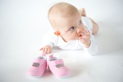 First shoes. Baby girl on white background Royalty Free Stock Photo
