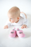 First shoes. Baby girl on white background Royalty Free Stock Images