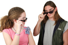 At First Sight 3. A teen boy and girl checking eachother out (focus is on girl) isolated Royalty Free Stock Photos