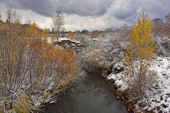 First snow. On banks of the river stock photos