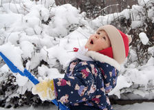 First snow. Little girl rejoices first snow Royalty Free Stock Photos
