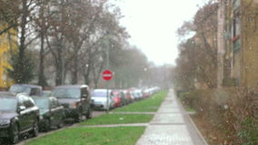 First Snow Blizzard In Prague City. Slightly defocused, mid focused, urban scene during blizzard stock video footage