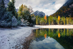 First snow on Braies Lake. Royalty Free Stock Image