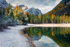 First snow on Braies Lake. Royalty Free Stock Images