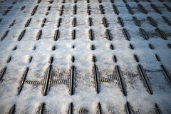 First snow covered wooden floor on balcony Royalty Free Stock Photo