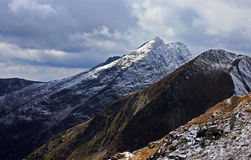 First snow in Fagaras mountains Stock Photos
