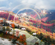First snow fall in the Carpathian village Stock Photography