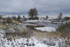 The first snow on the Lake. Rural Lake in Nizhny Novgorod region stock image