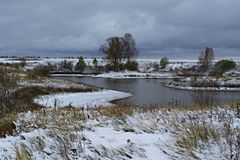 The first snow on the Lake._2. The first snow on the Lake. Rural Lake in Nizhny Novgorod region royalty free stock photography