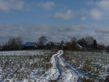 The first snow in the midland of Russia. Landscape with the village and the first snow in the midland of Russia royalty free stock images